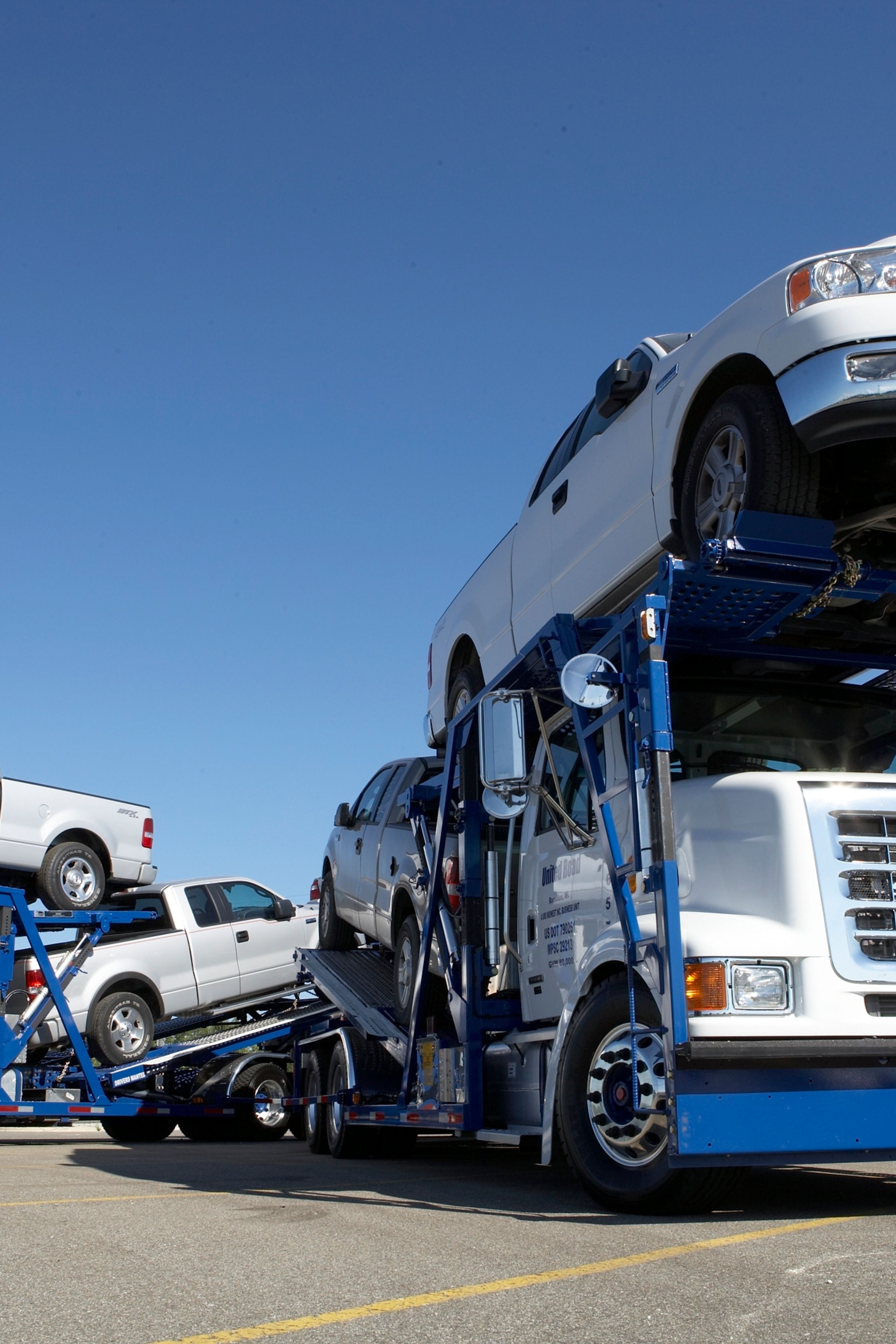 Affordable auto haulers standing by car carrier auto