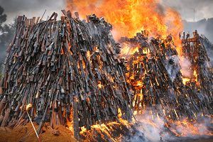 A Pile Of Illegal Firearms Burns In A Field On The Outskirts Of