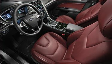 the 2015 fusion titanium shown with leather trimmed seats in brick red leather included