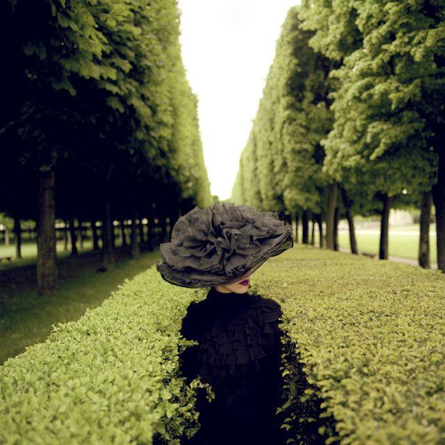 Woman With Hat Between Hedges, Parc de Sceaux, France, 2004, ©Rodney Smith