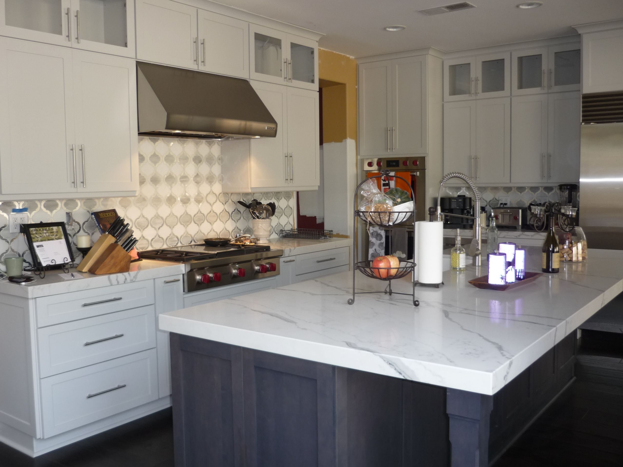 decora crushed ice cabinets with cobblestone island in san diego
