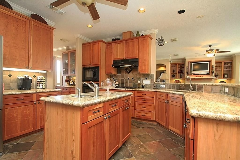 tile floor honey oak cabinets Google