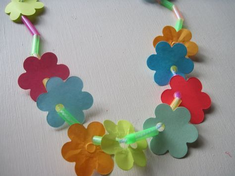 Make a lei using recycled paper scraps, straws and yarn!
