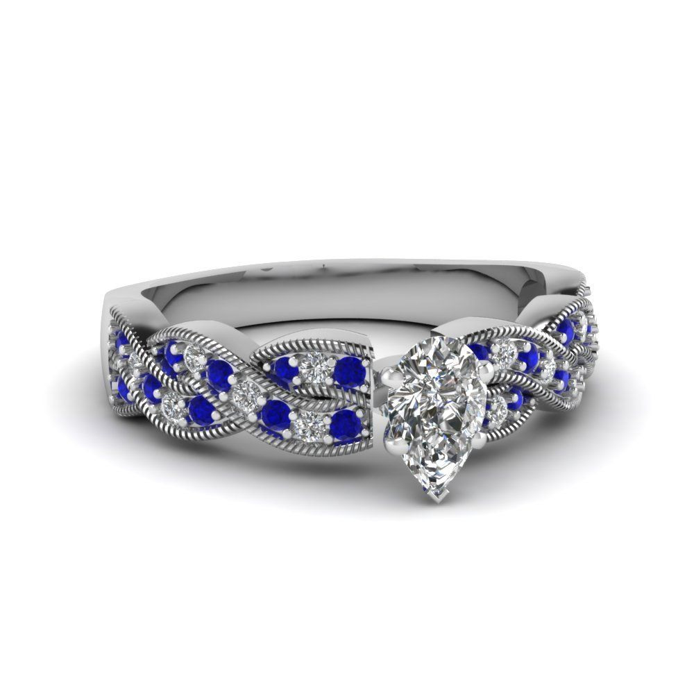 This enchanting side stone engagementring features a