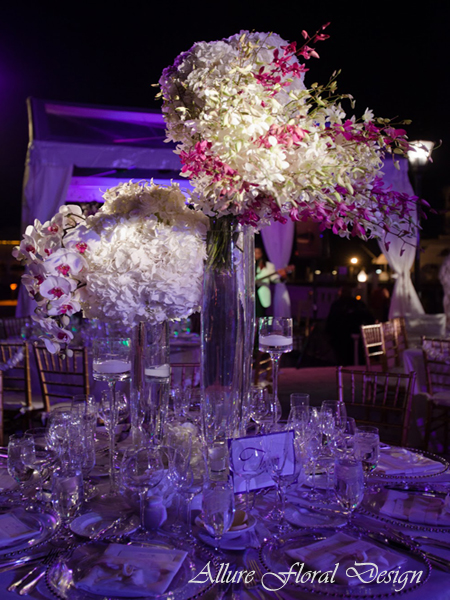 Tall centerpieces by Allure Floral Design, a Bloomerent florist based in New Jersey.