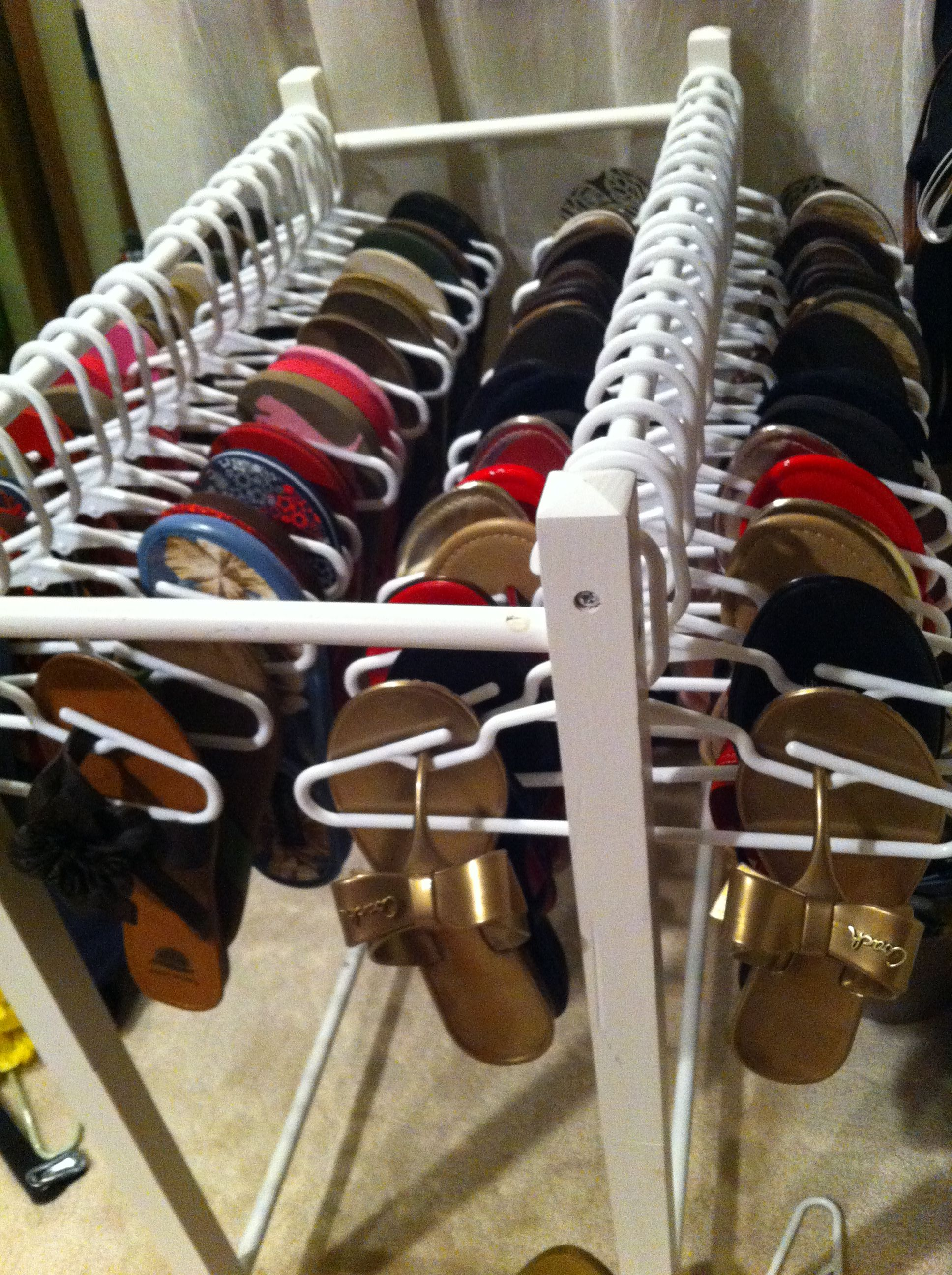 225ac2f34 Flip flop easy access! I don t like wire hangers so the idea of bending 60  coat hangers was too much. I purchased baby toddler hangers for 10  1.25  and used ...
