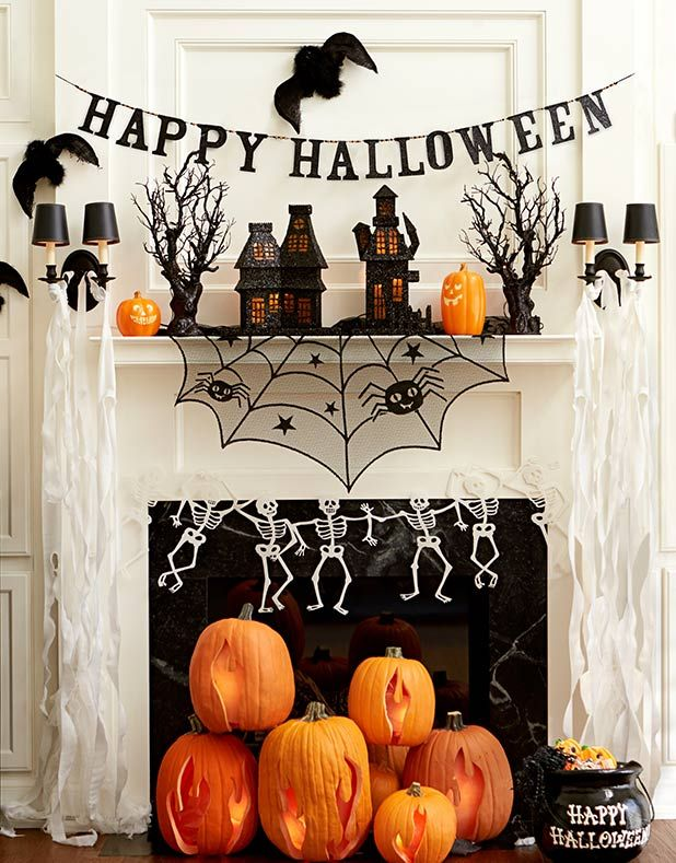 Stack pumpkins near the fire place and decorate the mantel for
