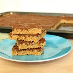 Peanut butter crispy treats topped with butterscotch and chocolate