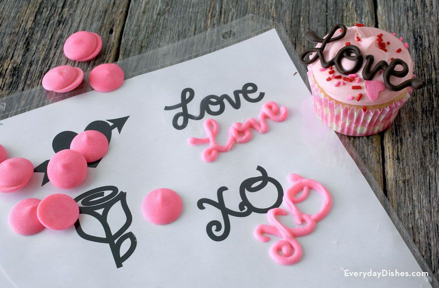 Making chocolate cupcake toppers isn't as hard as you think. Our printable template, candy melts and a little practice will have you piping like a pro!