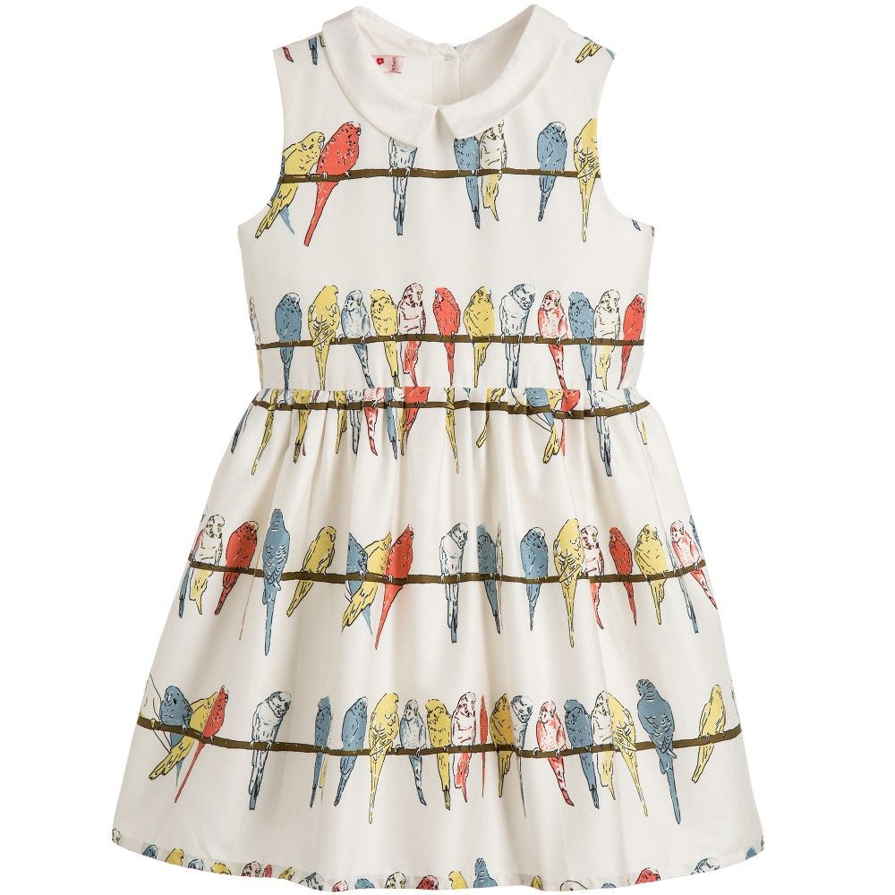 Girls ivory bird print dress by Bryony. Madeinsoft organic cotton sateen, this traditionally styled design is sleeveless and has been designed with plenty of room in the waist for growth. It has a prettybudgerigarprint, with a waist belt that ties in a bow at the back. It is fully lined and does up at the back with multi-coloured buttons.<br /> <br /> Model: Height 104cm (average 4 years)<br /> Size of dress shown in the photo: 4-5 years<br /> <ul> <...