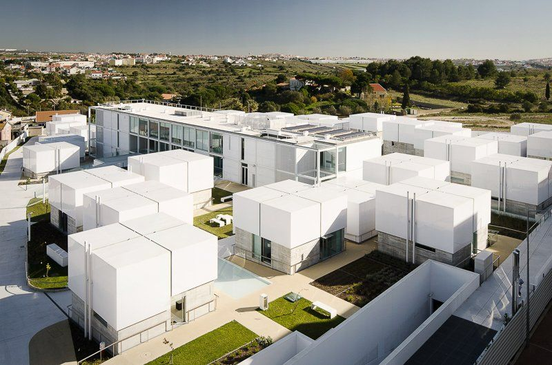 Guedes Cruz Builds Social Housing With Illuminating Box Roofs For The Elderly In Portugal Minimal Architecture Social Housing Architect