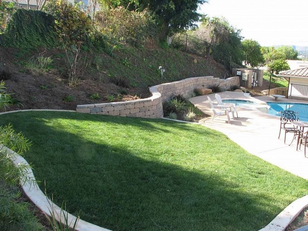 Sloped backyard landscaping designs with small pool for Big garden pools