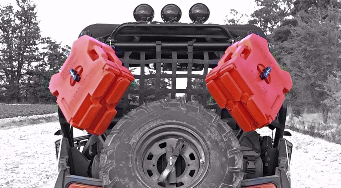 Rotopax Fuel Packs Mounted To The Back Of A Polaris Rzr