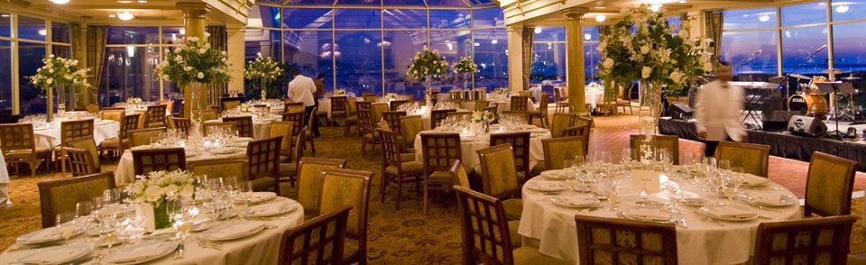 Wedding Venues: The Beach & Tennis Club, The Lodge at Pebble Beach. The beauty of a reception venue that has lots of windows is how they then reflect all the candles, votives and subtle lighting inside the room as it gets dark outside.  Lighting is so important and can change the atmosphere and look of a venue so quickly and easily.
