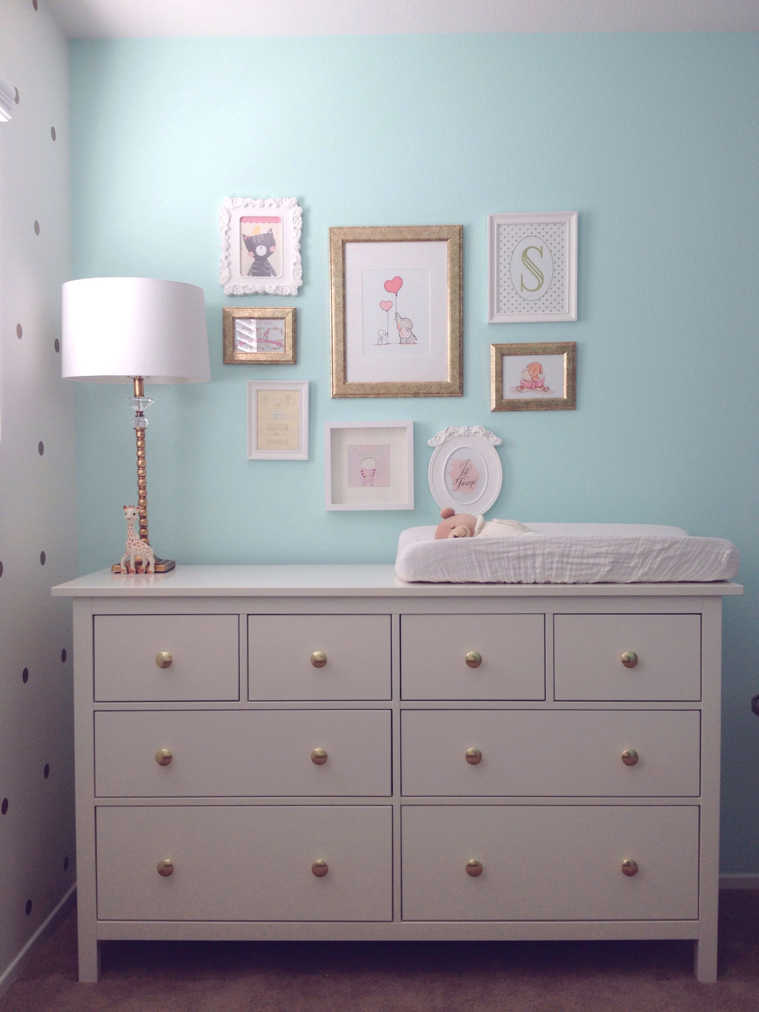 Mint & gold nursery.   Frames from IKEA. HEMNES dresser from IKEA. Gold knobs from Land of Nod.