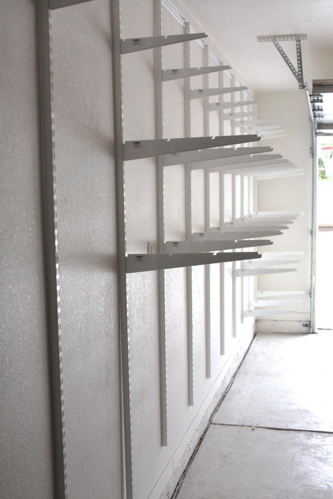 Simply Done Custom Wall Of Garage Shelving
