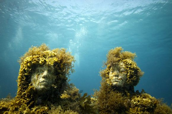 Jason deCaires Taylor anchors his sculptures on the ocean floor, where they get colonized by seaweed, algae and coral, turning them into living reefs.