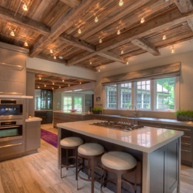 Room This Kitchen Features A Wooden Ceiling And Exposed Beams