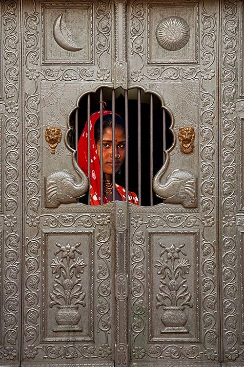 Gypsy girl behind a door, Pushkar, Rajasthan, India