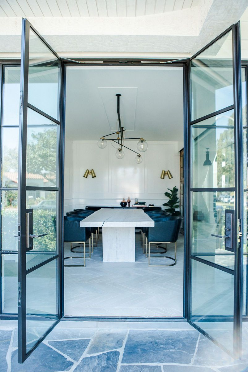 Dining space with slab table and cantilevered upholstered chairs. Leanne Ford Interiors #leannefordinteriors