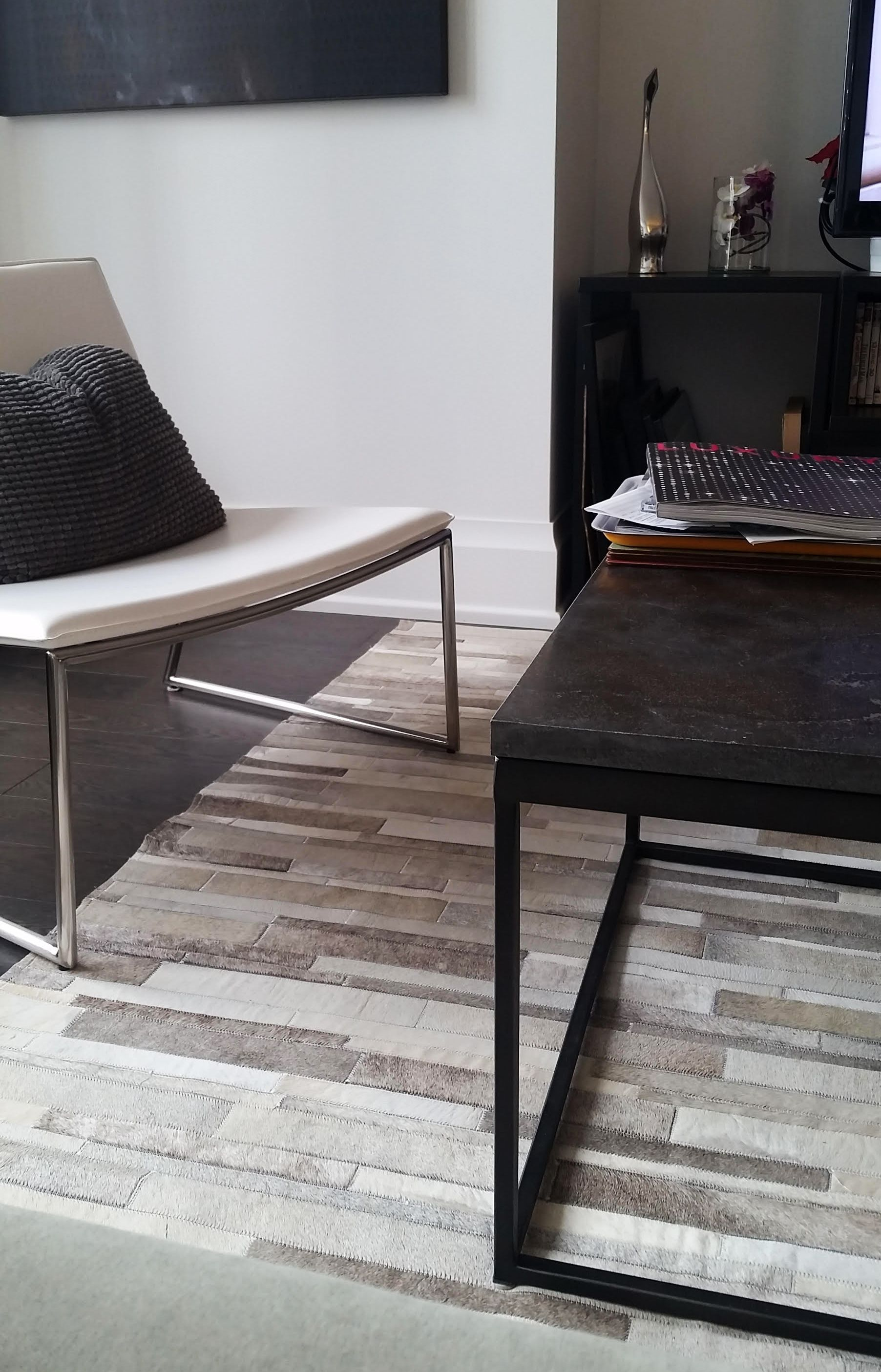 Super Corner In Jane S Home A White And Gray Patchwork Cowhide Rug Limits The Room And Lightens Up The W Patchwork Cowhide Rug Patchwork Cowhide Cow Hide Rug