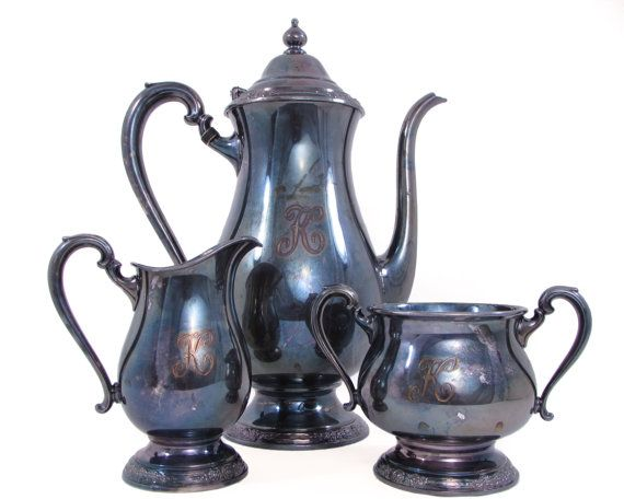 Camille by International Silver Company hinged teapot, sugar bowl and creamer. Note the sleek lines and floral design adorning the lid and pedestal