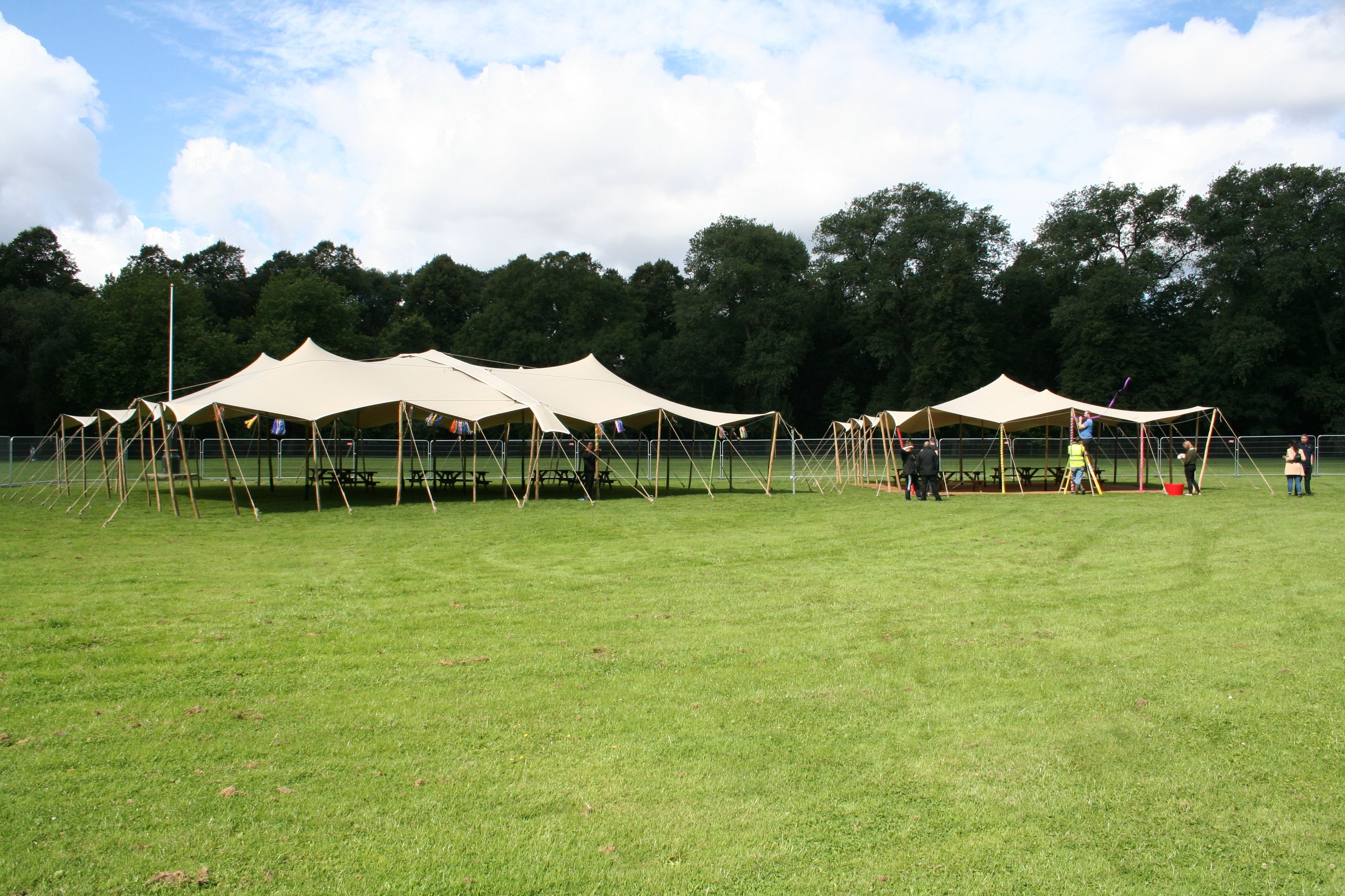 big stretch tent canopies on 10x15m and a 20x15m stretch tent wooden poles stretch tent hire & big stretch tent canopies on 10x15m and a 20x15m stretch tent ...