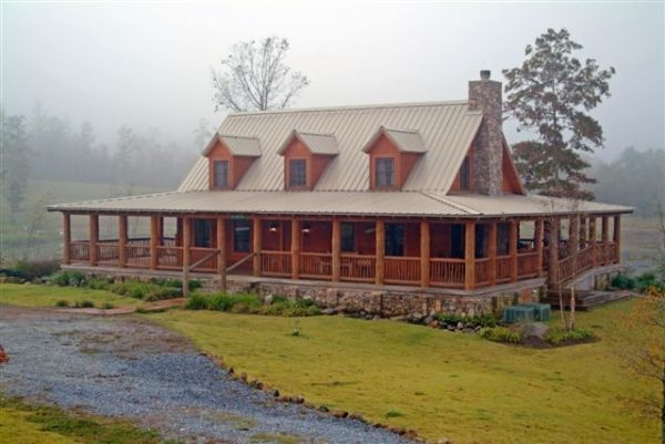 Log cabin with a tin roof and a wrap around porch. by InLovewithHim