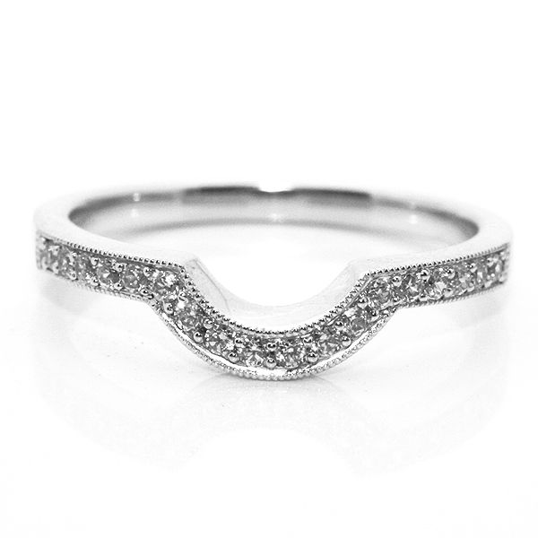 Elegant horseshoe shaped diamond wedding ring with millgrain edge