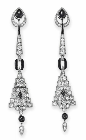A PAIR OF ART DECO DIAMOND AND ONYX EAR PENDANTS. Each suspending a circular and single-cut geometric plaque and tassel with onyx detail, from a circular and single-cut diamond line, to the onyx and single-cut diamond surmount, mounted in platinum and white gold, circa 1925.