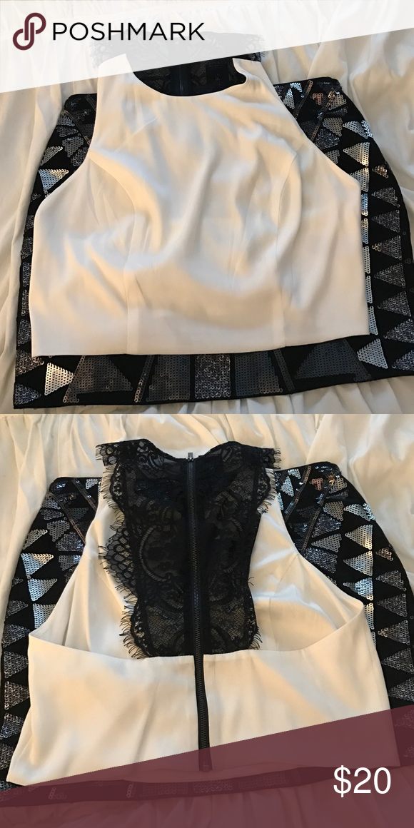White Crop Top White with black lace racer back with zipper feature. Brand New never been worn. Smoke free home. Open to offers. Express Tops Crop Tops