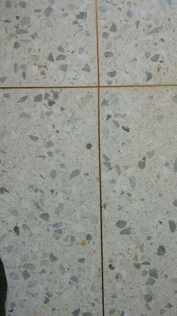 Golden brass spacers between the terrazzo tiles ...