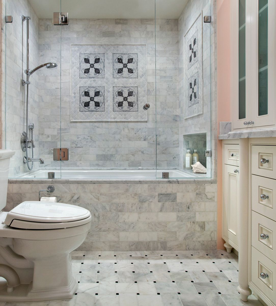 Tub view features Letoon marble tile. TRG Architects.