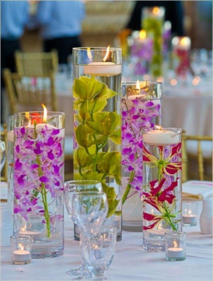 15 Beautiful Decorating Ideas For Wedding Reception Submerged Flowers Luau Wedding Luau Centerpieces