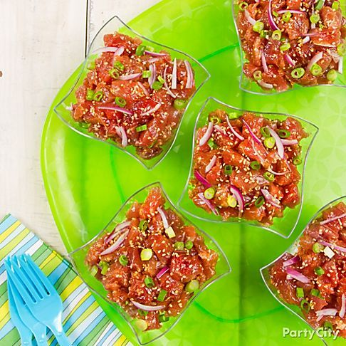 This quick-fix dish is an island favorite! Tuna Poke is a raw seafood salad, but your guests don't have to love sushi to enjoy! Click to learn how we make this refreshing treat!