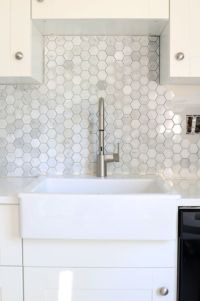an extremely detailed tutorial on how to install a marble hexagon tile backsplash they