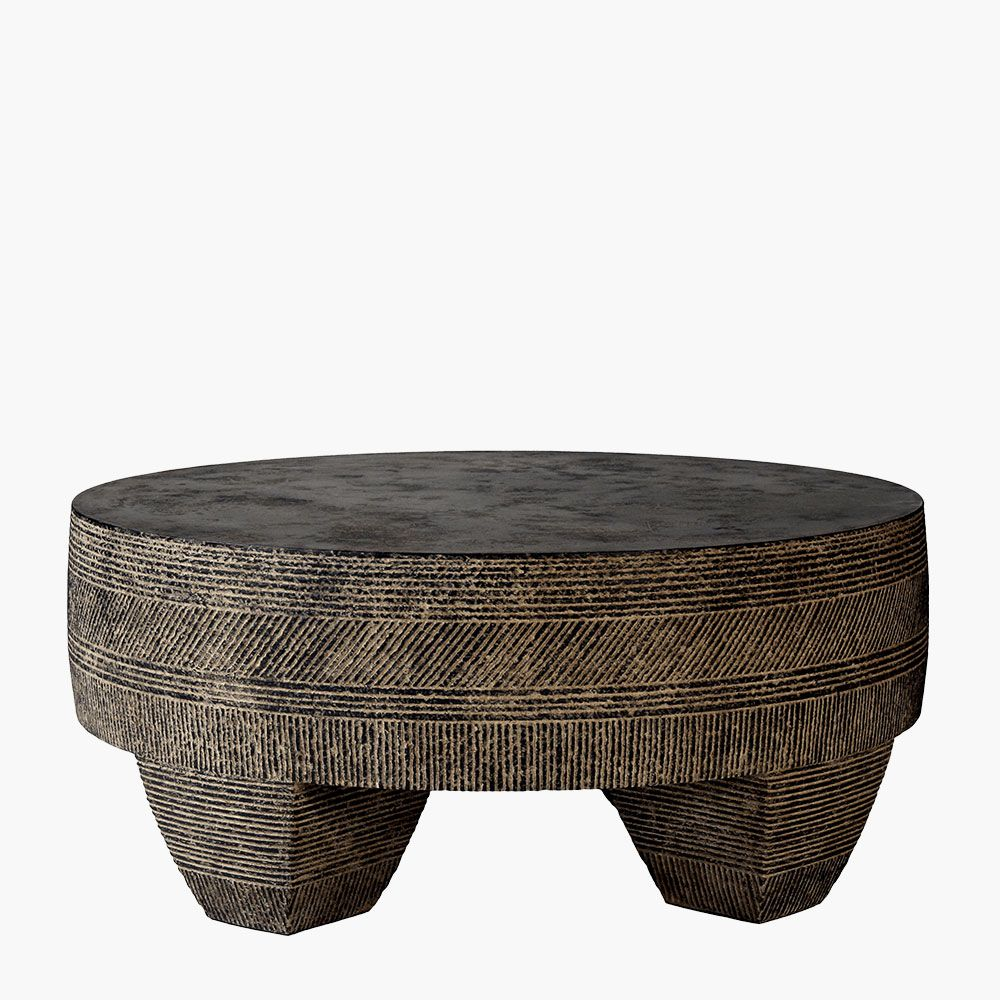 Tribal, natural, and primitive decor gets a boost of unique style with this hand carved stone table base. Modern form and organic texture for patios or living rooms.