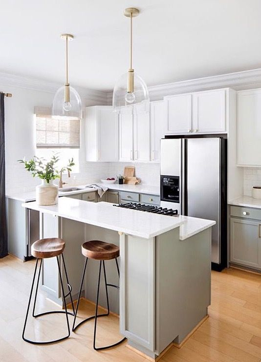 Boho Modern Kitchen With Wood And Iron Barstools Gold Pendant Lights And White Cabinets Pretty Kitchen Boho Kitchen Kitchen Design