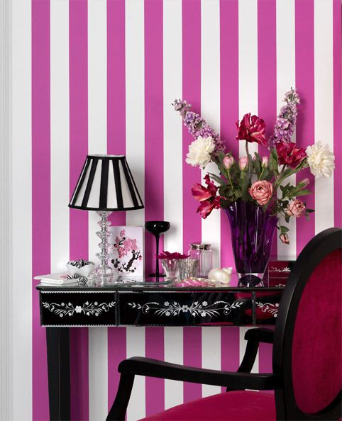 Vanity and pink striped wallpaper