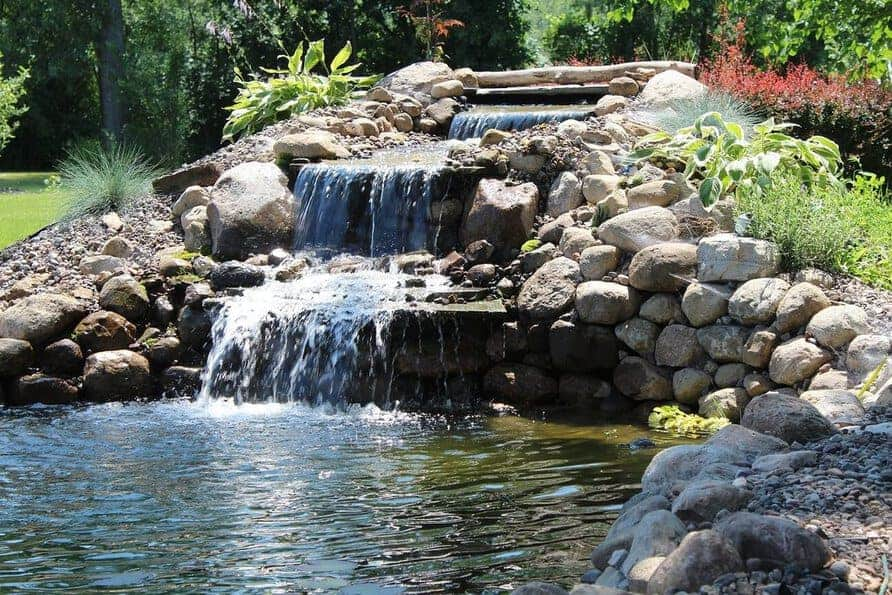How To Build The Ultimate Backyard Pond - Backyard Water ...