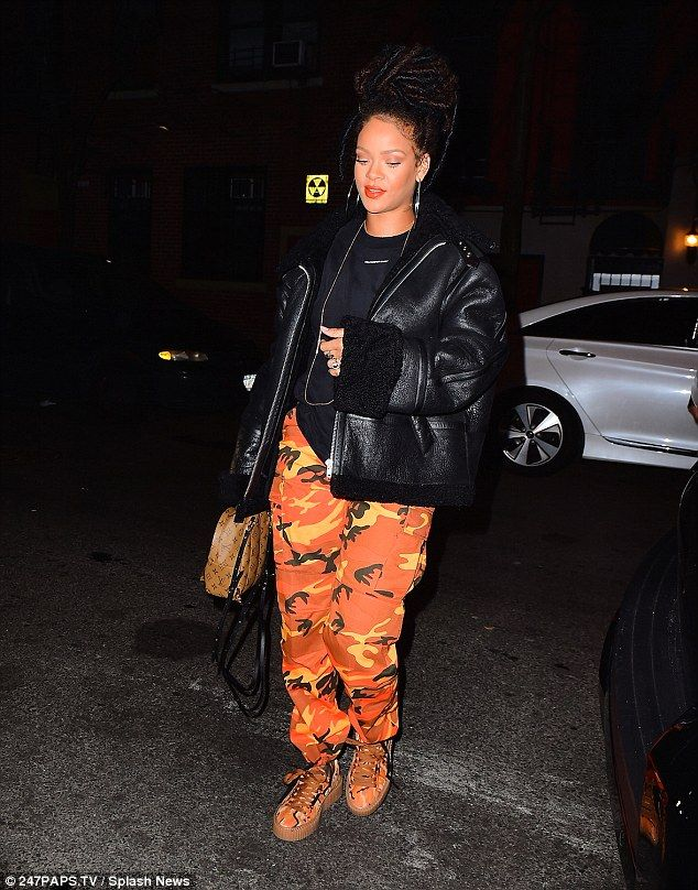 0b923b43300e Rihannais unmissable in orange camo pants and shoes from her line ...