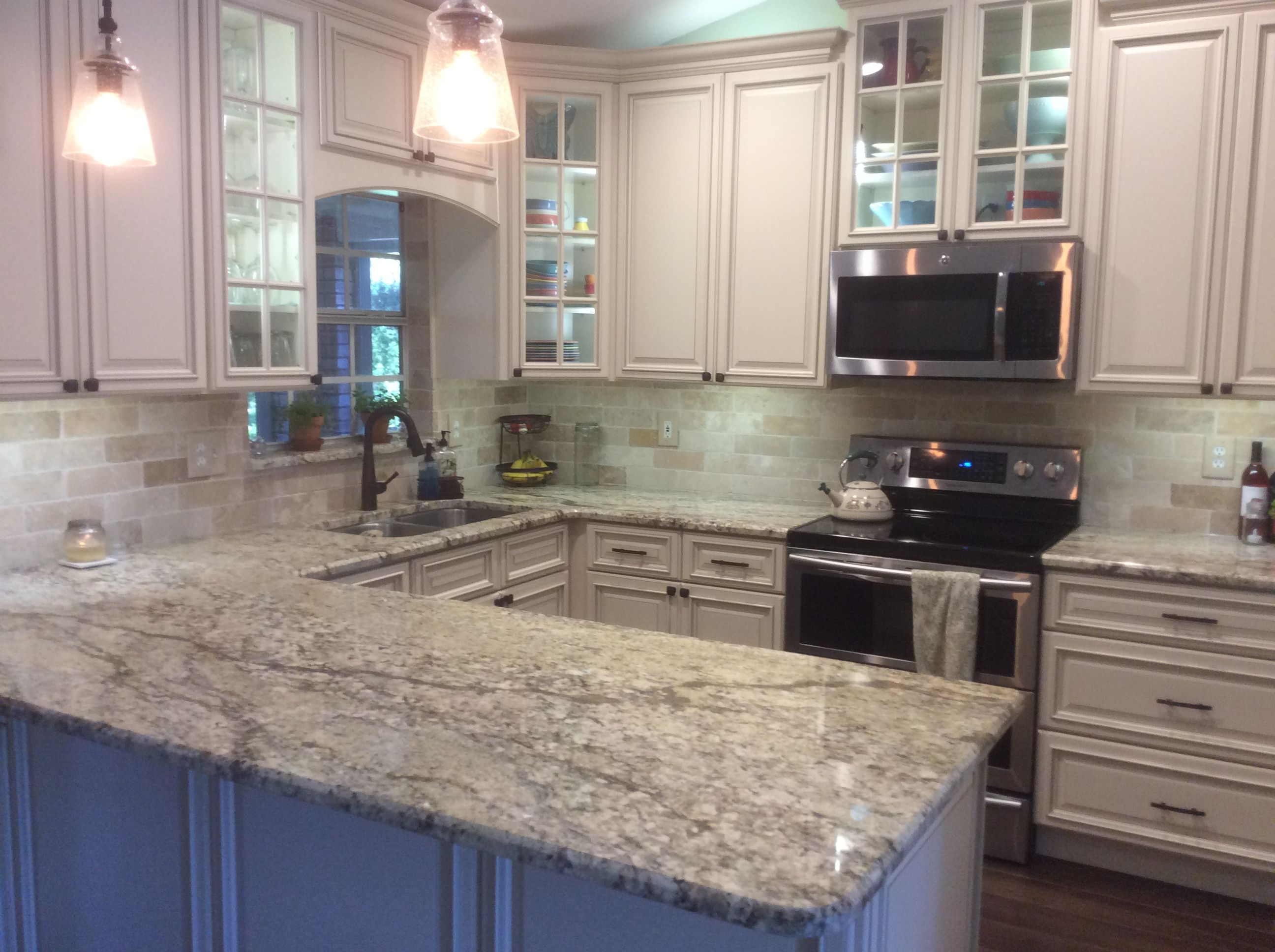 Forevermark Signature Pearl Cabinets, Yellow River Granite and Travertine backsplash/wall ...