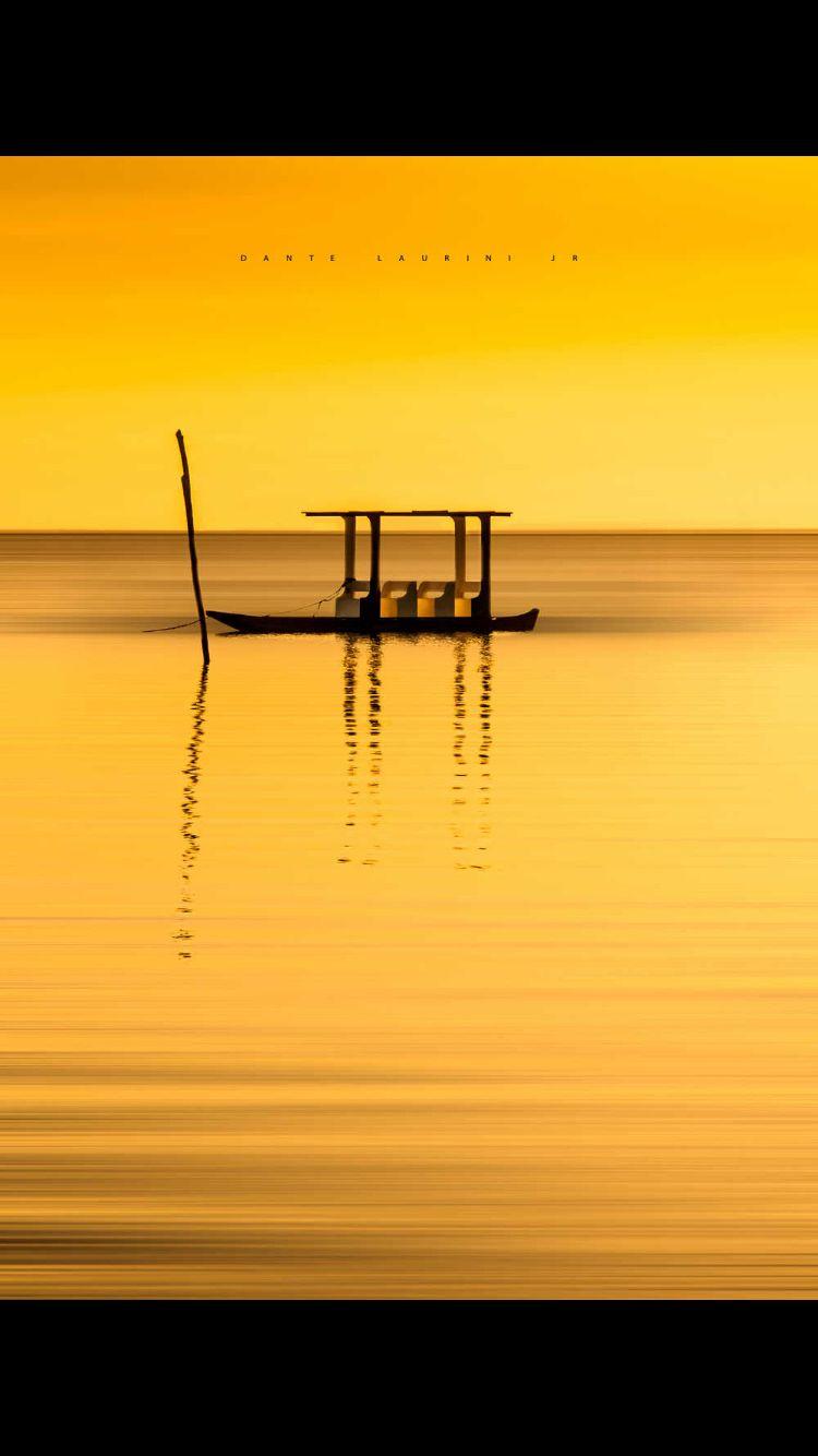 Boat in Alagoas nordeste Brasil yellow Barquinho amarelo low tide