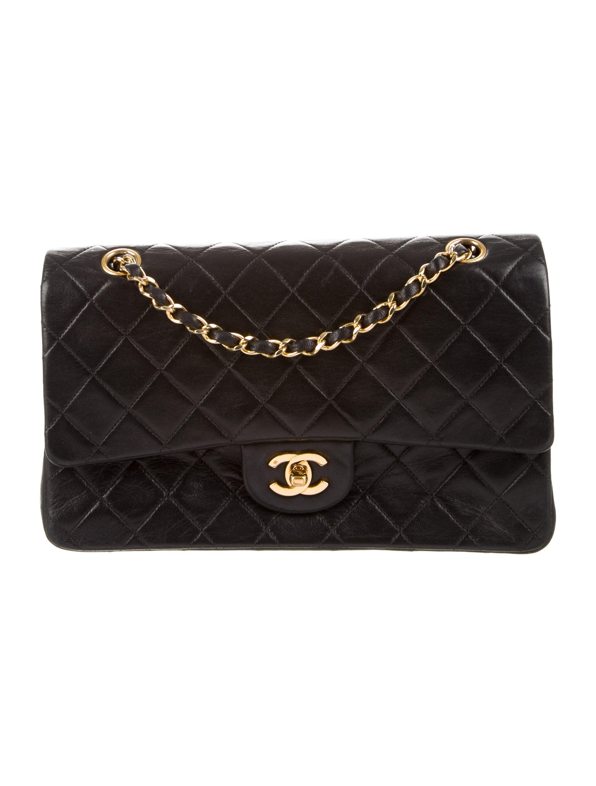 565cdb803ff0 Black quilted lambskin vintage Chanel Classic Medium Double Flap Bag with  gold-tone hardware