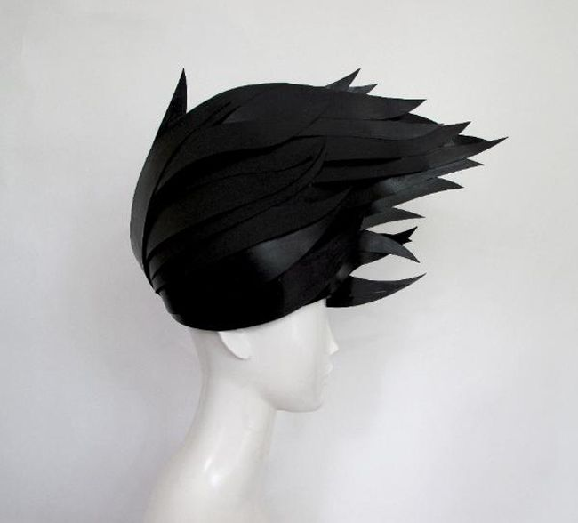 Black paper wigs created for Kate Spade window displays by studio Paper-Cut-Project.
