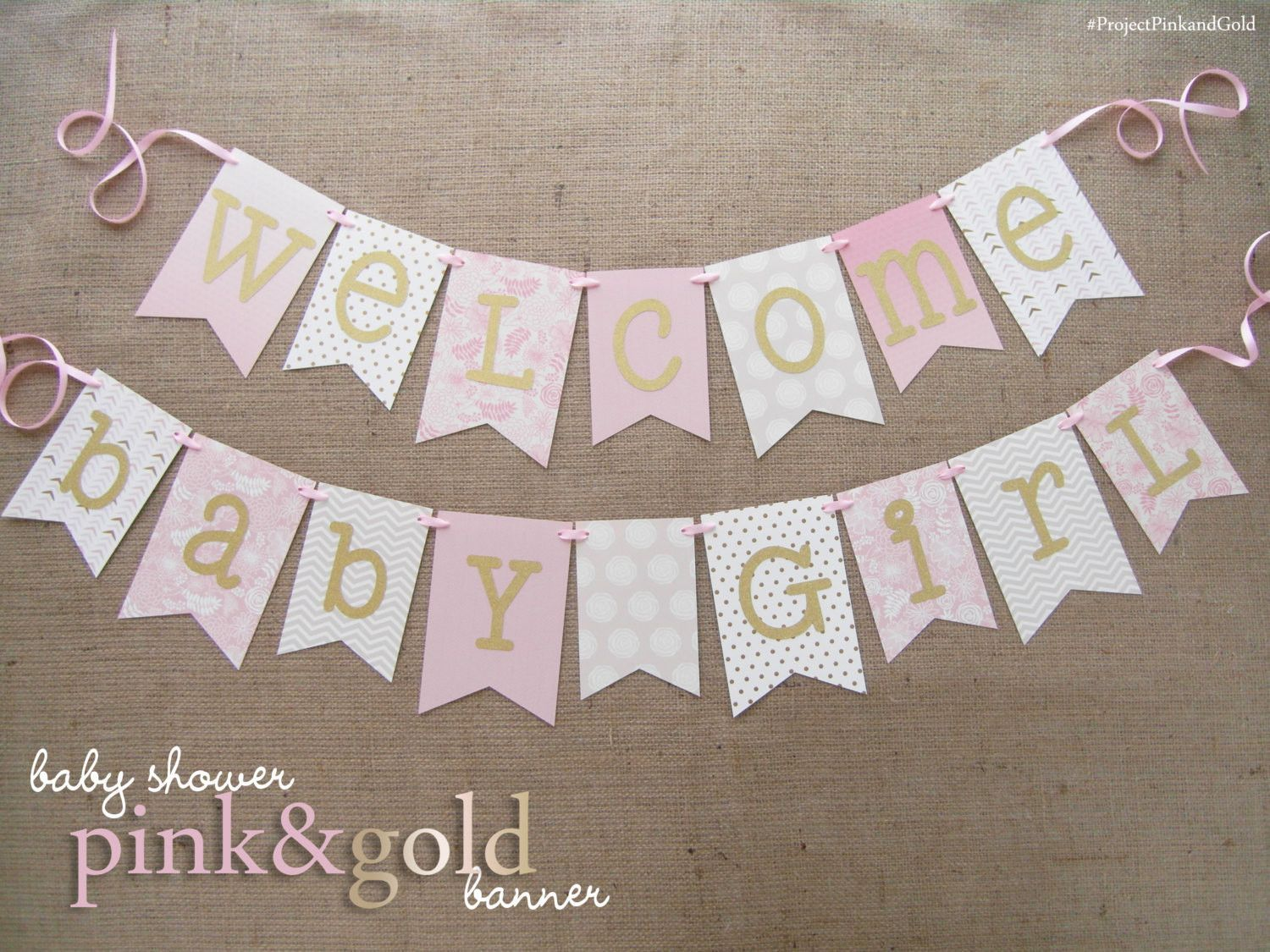 welcome baby girl pink and gold patterned medium weight cardstock gold glitter letters spans about 28 inches and 48 inches additional 12 inches of