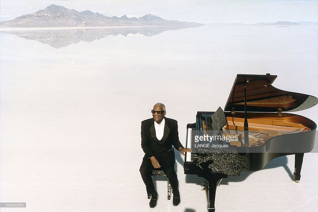 Singer <a gi-track='captionPersonalityLinkClicked' href=/galleries/search?phrase=Ray+Charles+-+Musician&family=editorial&specificpeople=206363 ng-click='$event.stopPropagation()'>Ray Charles</a> turns a commercial for the Cabriolet 306 of Peugeot in Salt lake in Utah on March 1994.