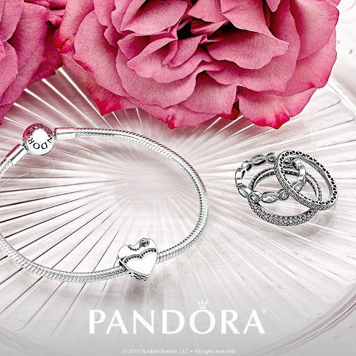 Celebrate your special day with this hand-enameled charm representing the bride on one side, groom on the other.   #shopdewaynes #hellospring #pandorajewelry
