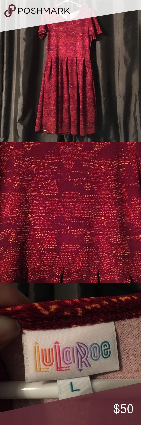 🦄 Lularoe Amelia!!! Beautiful Lularoe Amelia!!! Gorgeous red with orange and yellow tone design. So comfy!!! Has zipper back and two pockets!! Worn once. LuLaRoe Dresses
