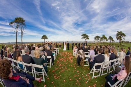 """ceremony at the lighthouse restaurant. overlooking the assawoman bay. yep. that's the name of the bay.  needs something to define the """"altar"""" though..."""